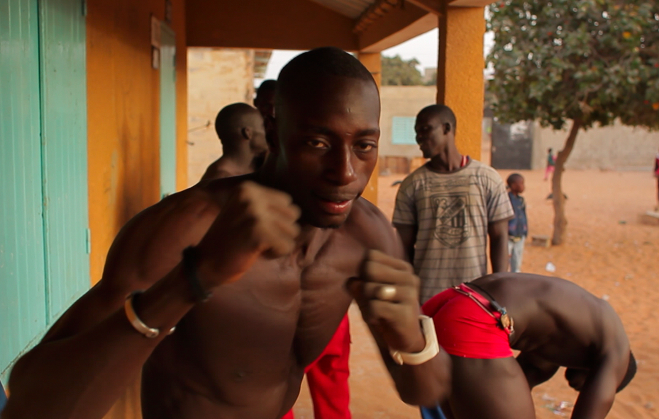Lamine - Wrestling in Dakar by Edward Porembny
